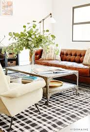 tour stylish office los. tour the stylish office of a hip los angeles company silver coffee table large plants and colorful artwork f