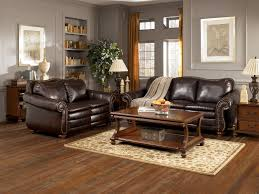 painting designs on furniture. grey wall living area paint and furniture design with brown sofas on the wooden floor painting designs