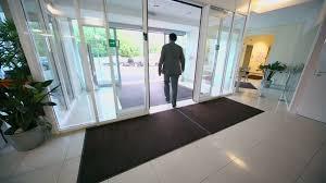 glass door office. Man Walks Through Entrance Glass Door Of Office Building Stock Video Footage - Videoblocks T