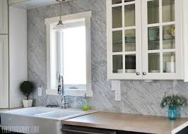 carrara marble backsplash. Simple Backsplash A Beautiful Vintage Industrial Kitchen Featuring Black And White Ikea  Cabinets Turquoise Accents A For Carrara Marble Backsplash