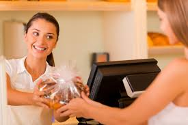 bill quiseng deliver the world s best customer experience please enjoy beautiful young female baker giving cookies to customer and smiling