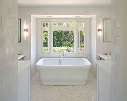 Master Bathroom With Waterworks Empire Freestanding Rectangular Composite  Bathtub And Calcutta Gold Marble Tile In Herringbone Floor.