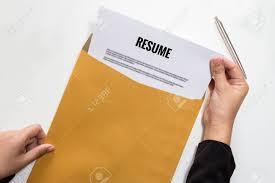 Envelope For Resume Woman Holding Resume Document In Envelope