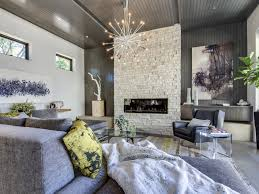 modern white bricks fireplace idea with glass cover and black frame