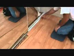 how to finish off a laminate planking floor edge next to a sliding closet door you