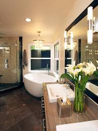 Bathrooms:Beautiful Bathroom With Small Bathtub Also Tiles Wall Under  Beautiful Chandelier And Wood Vanity