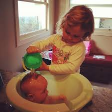 lucie baptizes baby alice in the tummy tub