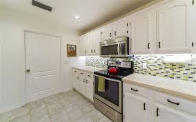 updated cabinets quartz countertops stainless steel appliances it s the perfect kitchen