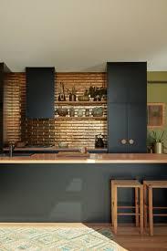 the kitchen backsplash tiles are perini tiles in jaca bronze their metallic glaze reflecting the