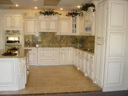simple kitchen design with fancy marble tiles backsplash also paired with antique white kitchen cabinets and