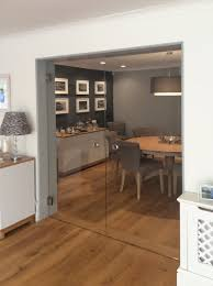 frameless glass doors with fiesta hinges and round flush handles