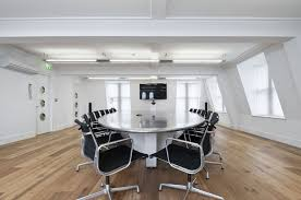 office meeting rooms. Office : Luxurious White Modern Meeting Room Idea With Black Chairs And Oval Table Along Wall Paint Color On Wooden Floor Stylish Rooms
