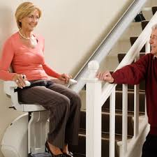 chair for stairs. Senior Citizen Sitting In Stair Chair Lift Going Up To Second Floor For Stairs H