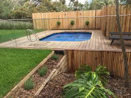 above ground pool with deck and hot tub. Above Ground Pool With Over Hanging Spotted Gum Deck And Curved Coping To Hide Hot Tub O