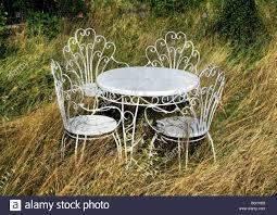 white metal outdoor furniture. Brilliant Outdoor White Metal Garden Table And Chairs In Overgrown Throughout White Metal Outdoor Furniture