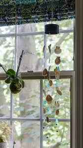 seashell seaglass windchime hanging in window