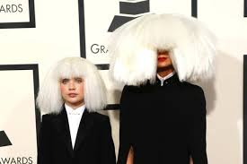 singer sia and moms star mad ziegler arrive at the 57th annual grammy awards in