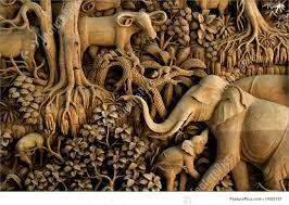 section of an ancient mural wood carving from thailand