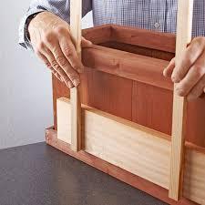 hold trellis against planter box