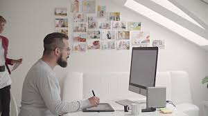 graphic design office. 4k: designers collaborating in their graphic design studio. video office
