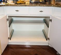 empty cabinet with new drawer slides installed for slide out shelves