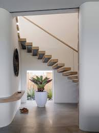 how to make your hallway feel bigger design tips white minimalist entryway with sliding