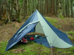 diy tarp tents are barebones shelters that provide everything you need and nothing you don t when you re in a survivalist situation