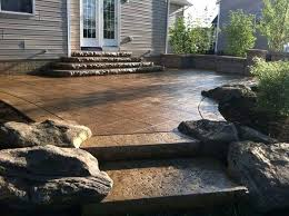 covered stamped concrete patio. Cement Patio Cost Brown Stamped Concrete With Rock Inlays  Canada Covered