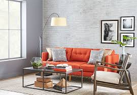 gray wall with painted and distressed faux brick