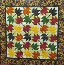 Colorful Maple Leaf Quilt & picture of an autum leaf quilt with bright leaves Adamdwight.com