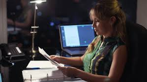 Image result for a woman working in an office at night