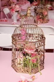 flower arrangements in bird cage  Birdcage CenterpiecesBirdcage  DecorCentrepiecesBird ...