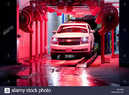 Car Wash Tunnel Design Giant Blowers Drying An Automobile At A Tunnel Car Wash In