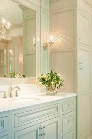 bathroom features gray shaker vanity: traditional gray bathroom features gray shaker vanity cabinets paired with white quartz countertops under an inset