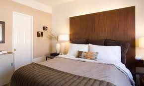 Last year, we posted about some DIY headboard ideas we found at the Better  Home & Garden's site. We actually made ours with some plain closet doors.