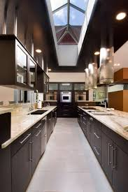 bob wallace appliance with contemporary kitchen and cylinder hood dark stained wood cabinets flush work galley kitchen hanging cabinets recessed lights sky
