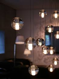 lighting in the form of suspended glass orbs by bocci photography by spencer hung refuge lighting lighting photography and galleries