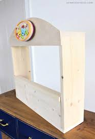kids play puppet theater