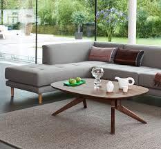 cross oval coffee table 1 cross oval coffee table matthew hilton walnut lifestyle 1
