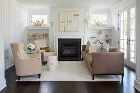 fireplace with built in shelves below windows