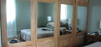 combination raised panel and mirrored sliding closet doors
