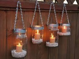 mason jar lighting mason jar lighting hanging on a fence mason jar lighting fixture diy room