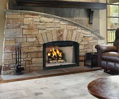 Comfy Brown Leather Couch Beside Stone Gas Fireplace Insert With Blower  Plus Black Tool Kit Under ...