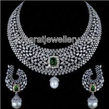 checkout white gold finished elegant designer diamond heavy necklace sets with curved diamonds and emeralds attached with south sea pearls at the bottom of