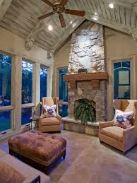modest sunroom decorating ideas. i really like this fireplace design and the large cedar mantle for outdoorporch modest sunroom decorating ideas o