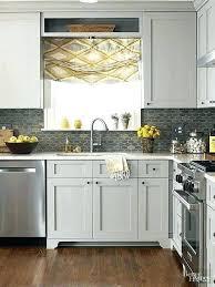 gray subway tile backsplash dark grey kitchen light gray wooden kitchen cabinet contemporary steel stove dark