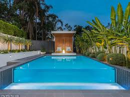 infinity pool cost. brisbane homeowners spend over 30k to create waterfall style pool infinity cost r