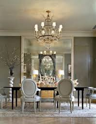 grand dining room in gold and silver layering mirrors