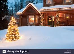 christmas trees decorated outside snow. Wonderful Decorated Lit Christmas Tree In Front Of Log Home Decorated With Lights And  Decorations Anchorage With Trees Decorated Outside Snow O