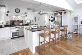 tile to hardwood transition white ceramic tile light wood floor white kitchen furniture with black top